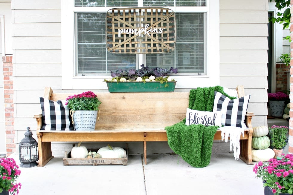 A porch full of vintage, thrifted and new decor. Tips on how to mix them seamlessly into your decor.
