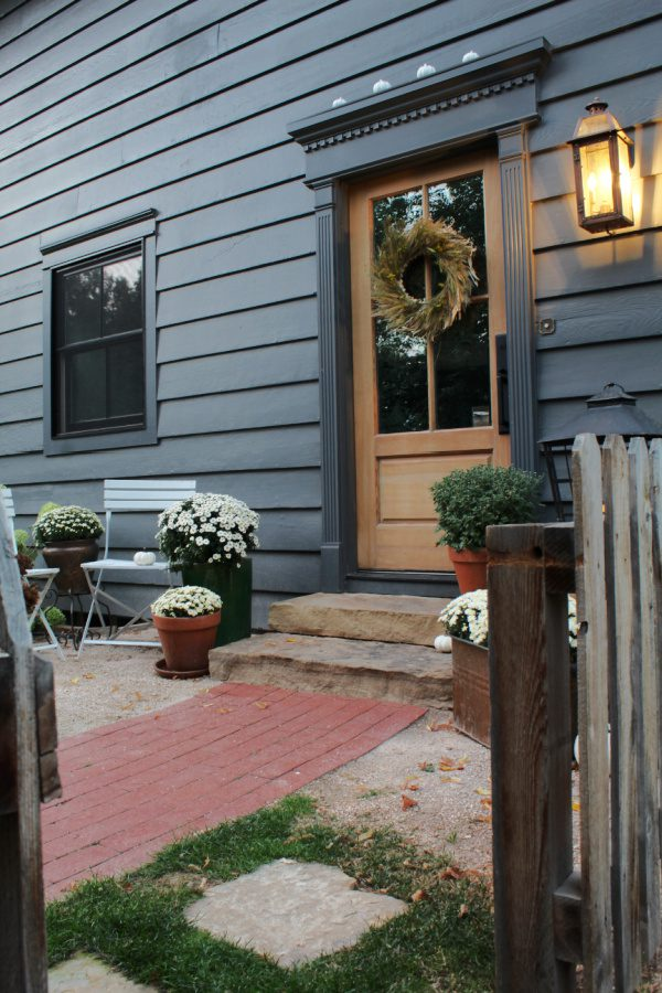 Fall steps with contrasting decor lead to a charming entrance.
