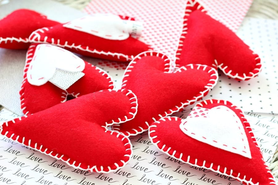 red felted heart pillows with love notes