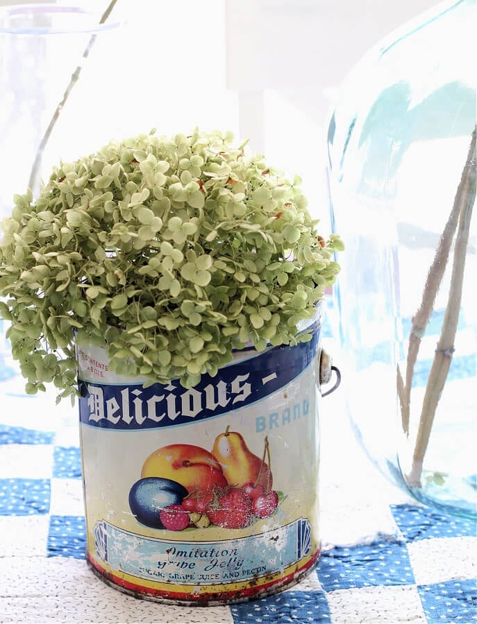 Learn how easy it is to create a flea market style Spring centerpiece.