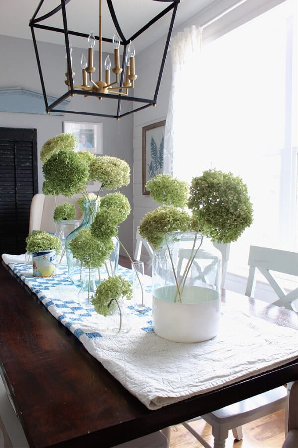 Check out this gorgeous flea market style Spring centerpiece featuring dried hydrangeas.