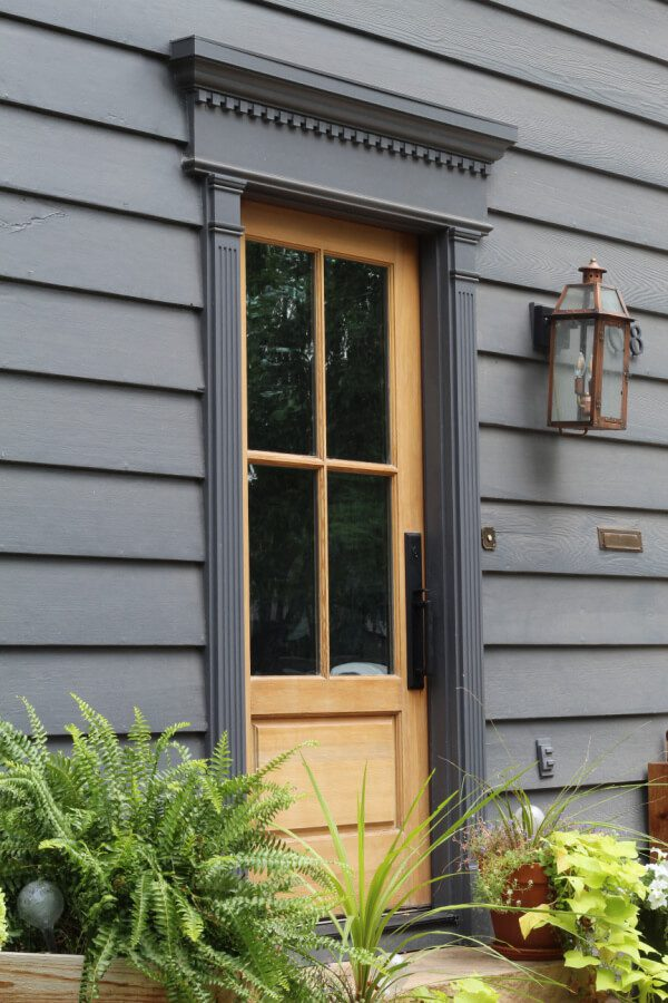 Our wood front door stole my heart. I love how beautifully it contrasts agasint the SW Peppercorn paint color of the house!