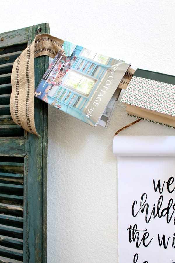 DIY book garland attached to shutters.