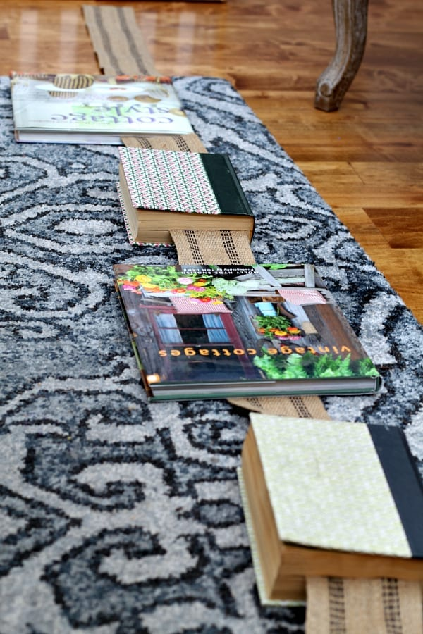 Laying out the books for the DIY book garland.