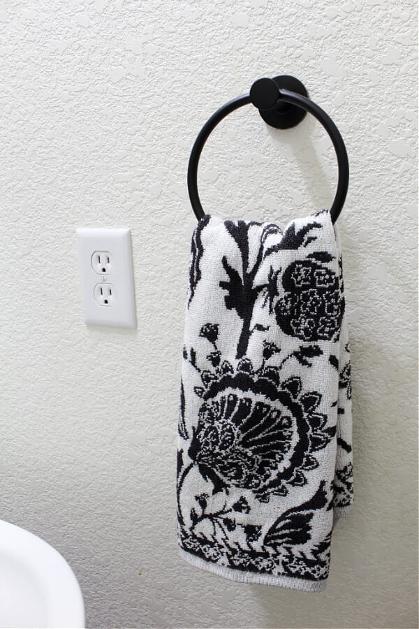 black and white towel and new towel ring