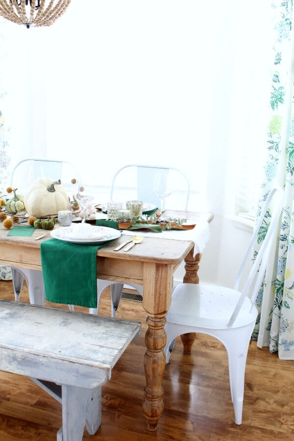 Our kitchen nook and weathered old table create the prefect setting for a cozy Thanksgiving table.