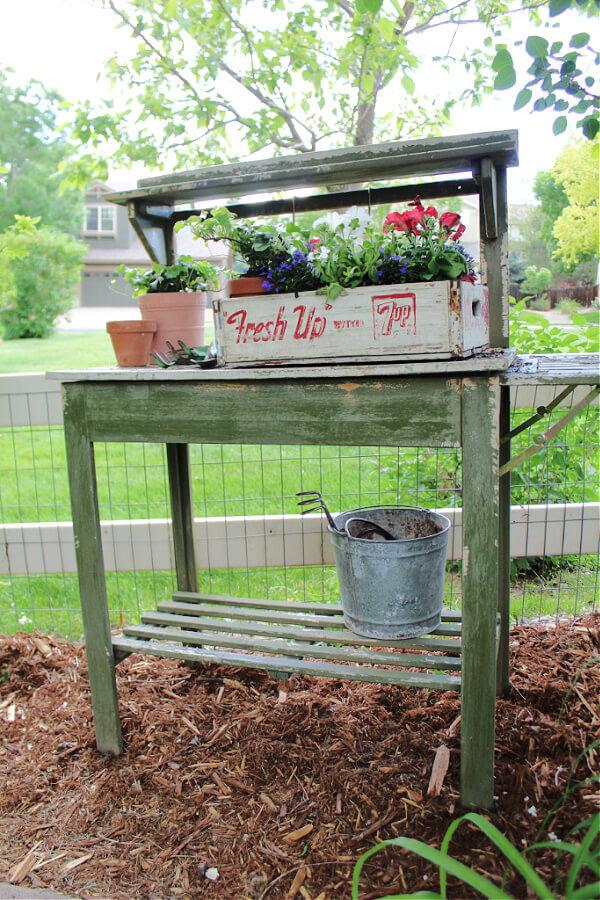 Vintage planter on weathered potting bench