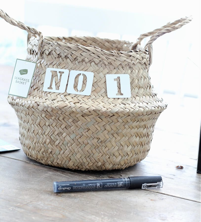 Using paint pens to stencil a sea grass basket from Target