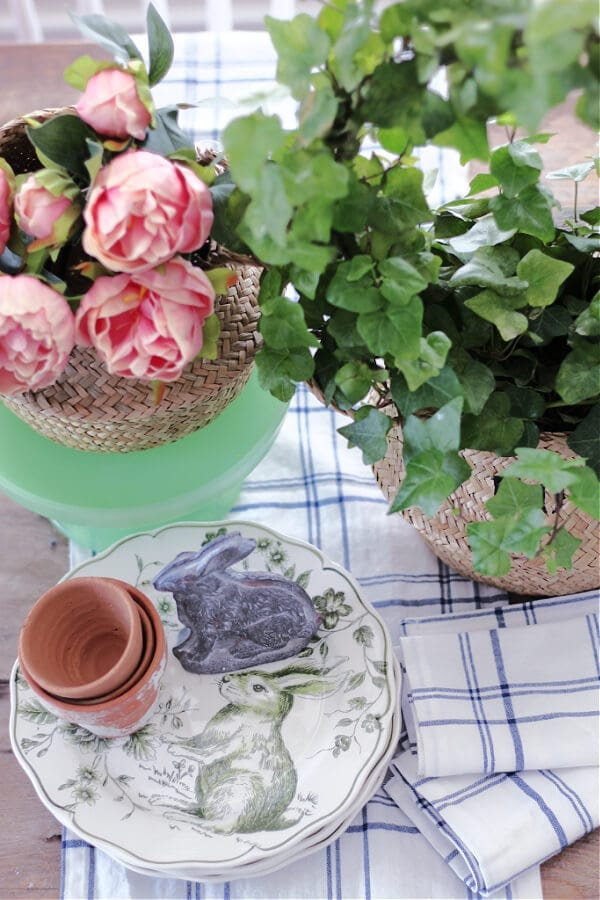 A peek at a pretty Spring vignette with sea grass baskets and pink peonies.