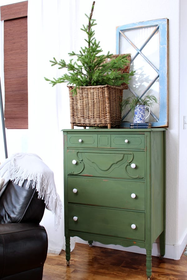 An old dresser painted Boxwood green is decorated for winter.