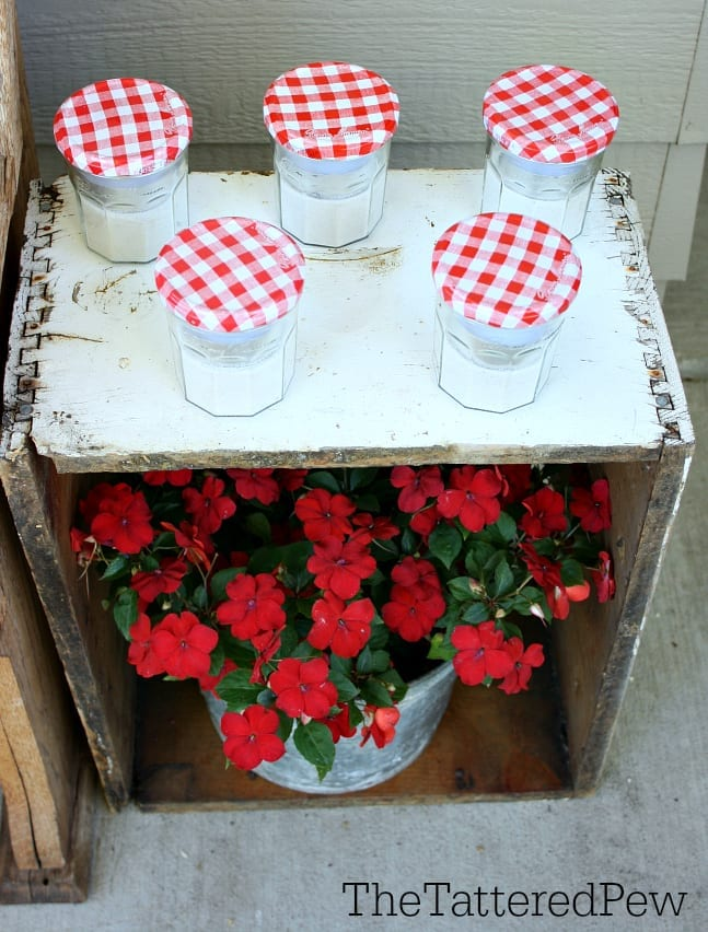 Jelly jar votives for your front porch.