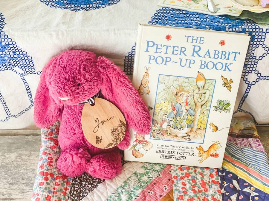 A Peter Rabbit pop up book, Jelly Cat bunny and personalized Easter basket tag make for a fun Easter table.