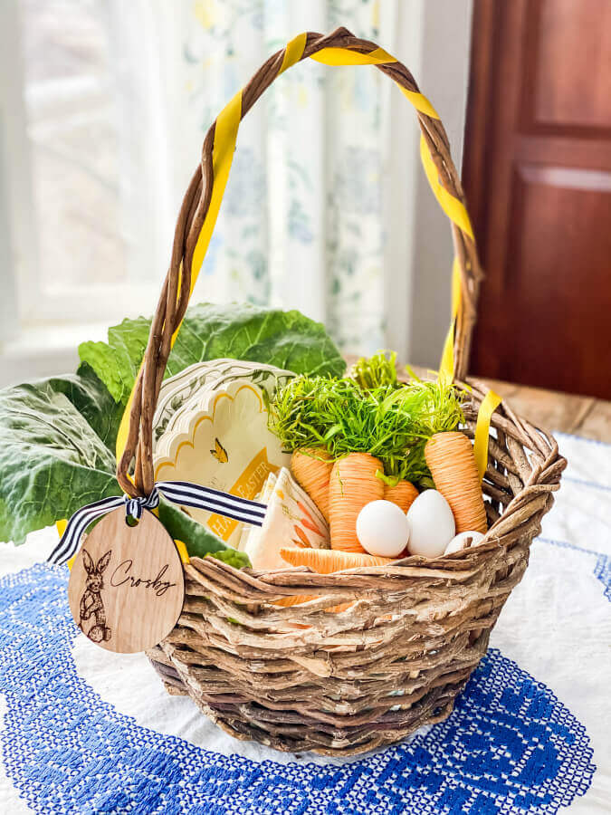 A giant sized Easter basket serves as the perfect centerpiece for this kid friendly Easter table.