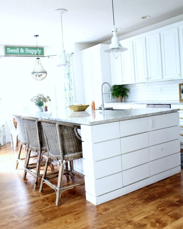 A light and bright kitchen thanks to our newly refinished cabinets.