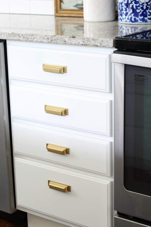 Rejuvenation hardware in aged brass was the finishing touch to our newly refinished cabinets!