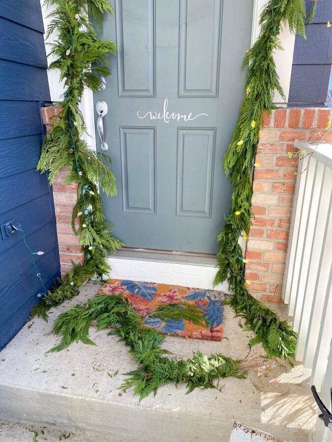 Extra garland from our door was used to make a wreath for our front window.
