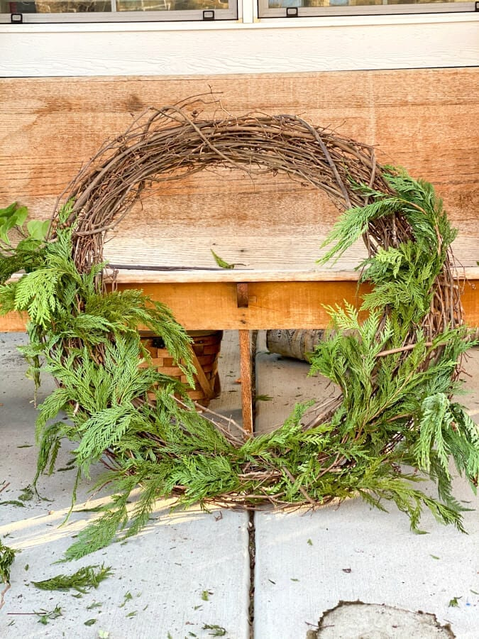 How to make a large outdoor Christmas wreath with items you already have.