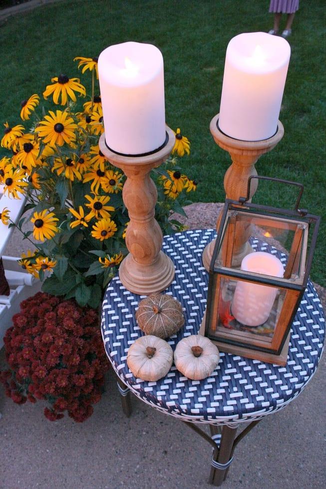 Candlesticks , lanterns and pumpkins for outdoor Fall decor.