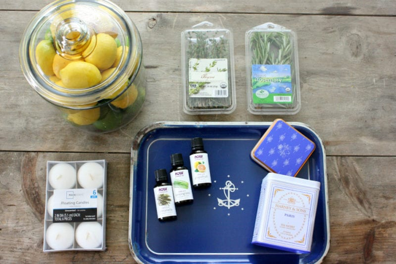 Everything you need to make DIY citronella candles infused with essential oils.