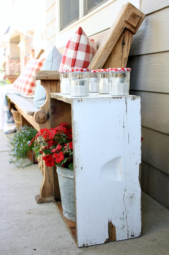Old jelly jars turned into votives are a simple and affordable addition to any porch.