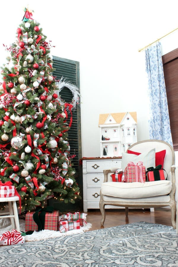Our tree is full of red ribbon , mercury glass ornaments and pops of plaid!