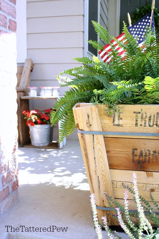 Patriotic touches to our front porch are perfect for Summer fun!