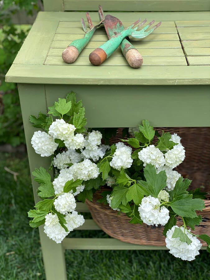 A budget friendly potting bench makeover with Boxwood green.