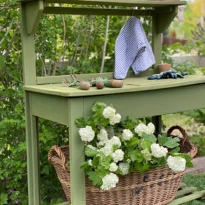 This World Market potting bench makeover got a fresh coat of Boxwood green milk paint!