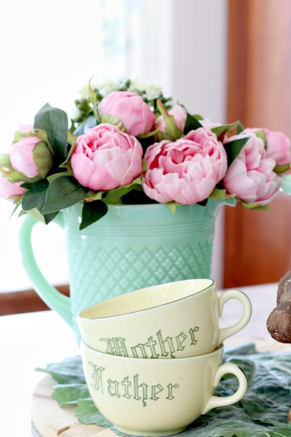 pink peonies, jadeite pitcher and yellow vintage mugs that scream Spring is near!