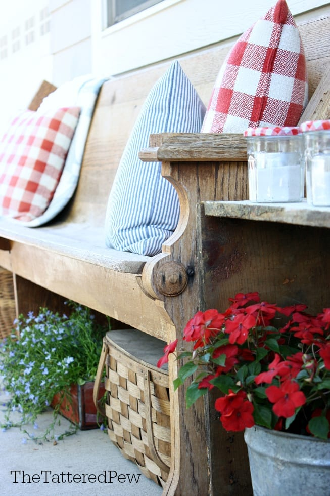 Darling porch decor using old jelly jars for votives.
