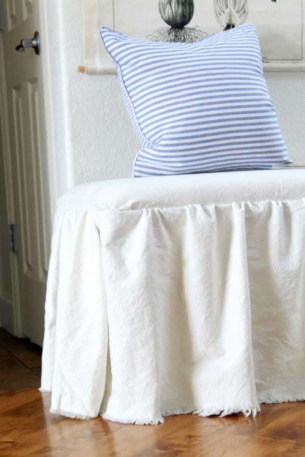 How to recover a bench and add a no sew skirt for a fun and quick DIY.