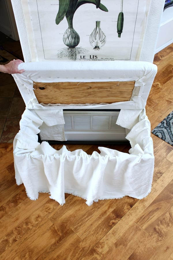 Use the recovered bench lid to secure and hold the no sew skirt in to place.