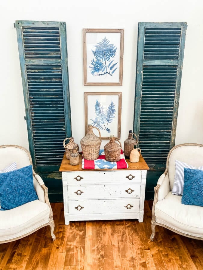 My favorite dark green vintage shutters take up a lot of space on our large wall in our family room.