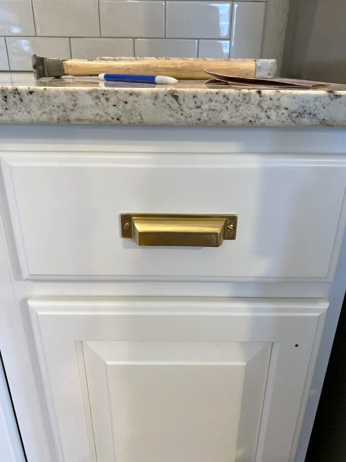 Adding the hardware to our newly refinished cabinets was easy and quick to do!