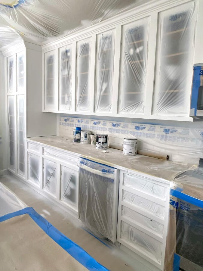 A view of our cabinet boxes after they were primed and painted and waiting for the doors.