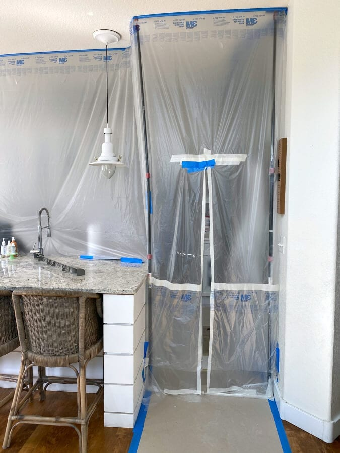 Our kitchen was taped off and properly taped and sealed to protect it from the new cabinet paint.