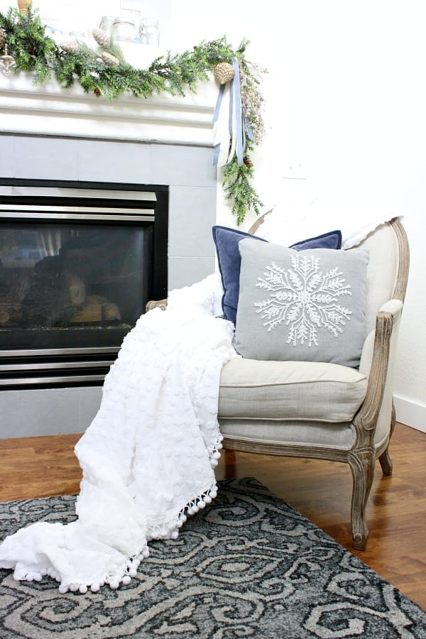 A rustic and elegant mantel with hints of soft blue for Christmas.