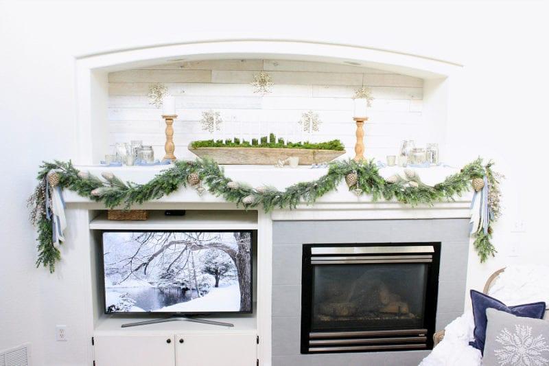 A rustic and elegant Christmas mantel.