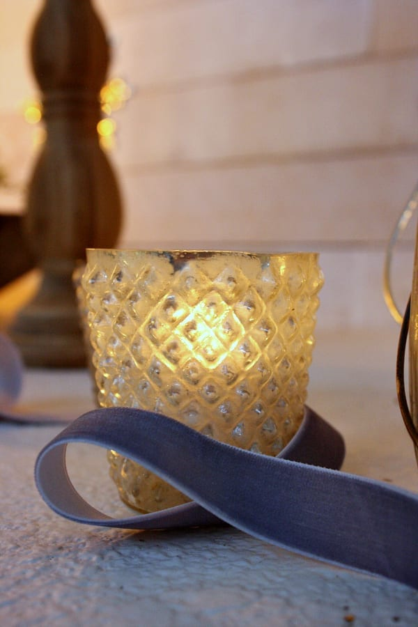 Mercury glass votives are the perfect Christmas detail for your mantel.
