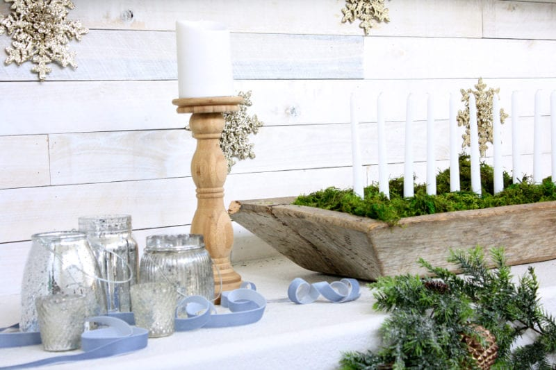 A beautiful rustic and elegant Christmas mantel with subtle pops of blue.