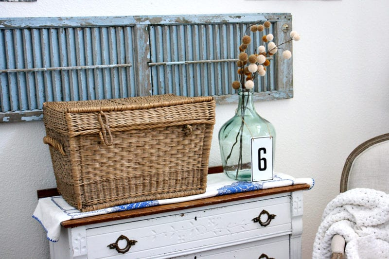 A beautiful basket and warm Fall colors mixed with blue are one way to usher fall decor in.