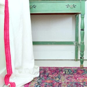 THetse pink and white no sew drop cloth curtains look custom for a fraction of the price!