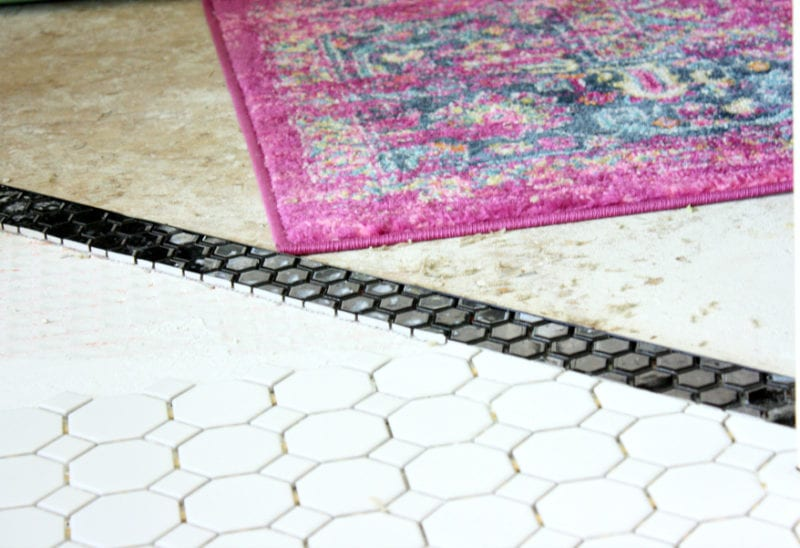 THe black strip of tile adds just the right amount of detail to the entryway.
