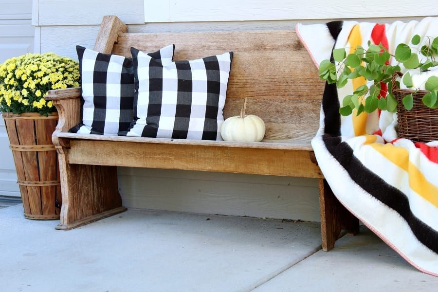 Simple tips and tricks for adding vintage decor to your Fall porch.