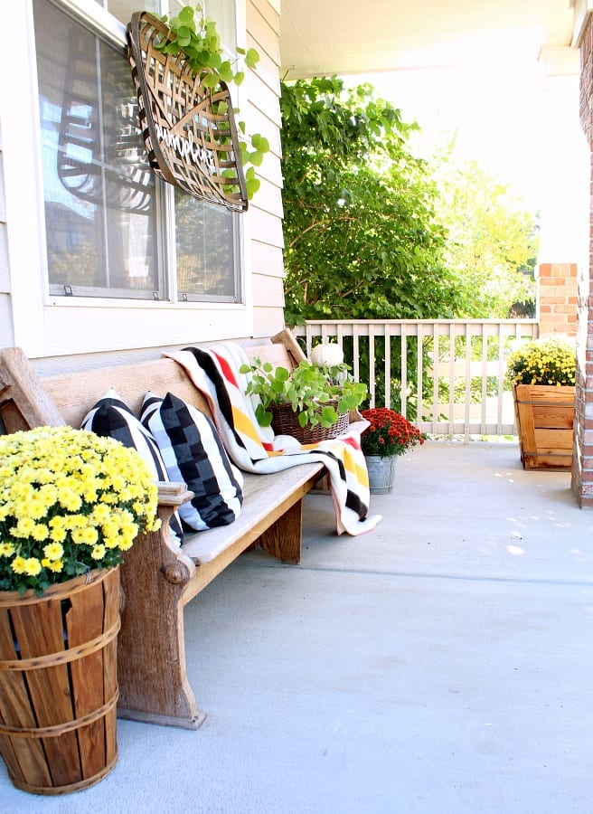 Touches of vintage decor on our Fall porch add instant charm and character.