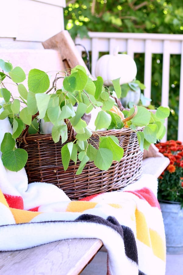 This imitation Hudson Bay blanket and basket are the perfect pair for this Fall porch.