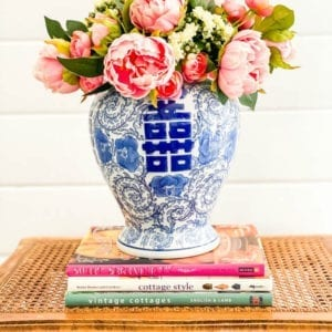 How to style a faux flower arrangement in a blue ginger jar.