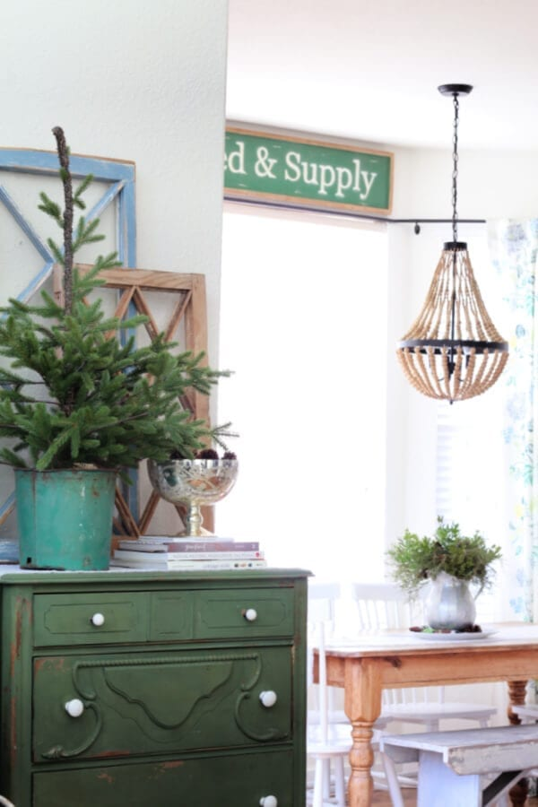 Blues, greens and live greenery make this winter kitchen cozy and pretty!