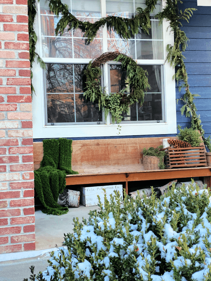 Winter porch ideas that include keeping up your greenery!