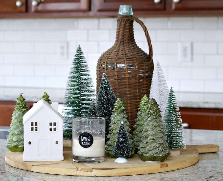 I love using trees and candles for cozy winter decor.